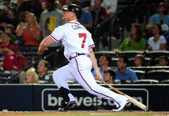ATLANTA - JUNE 16: Brooks Conrad #7 of the Atlanta Braves hits a 9th inning home run against the New York Mets at Turner Field on June 16, 2011 in Atlanta, Georgia. (Photo by Scott Cunningham/Getty Images)