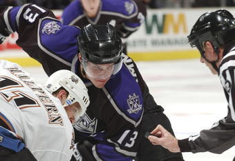 LOS ANGELES - DECEMBER 14:  Michael Cammalleri #13 of the Los Angeles Kings faces off against Jeff Halpern #11 of the Washington Capitals on December 14, 2005 at the Staples Center in Los Angeles, California.  (Photo by Noah Graham/Getty Images)