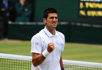 LONDON, ENGLAND - JULY 01:  Novak Djokovic of Serbia reacts to a play during his semifinal round match against Jo-Wilfried Tsonga of France on Day Eleven of the Wimbledon Lawn Tennis Championships at the All England Lawn Tennis and Croquet Club on July 1,