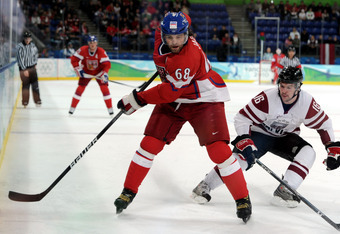 VANCOUVER, BC - FEBRUARY 23:  Jaromir Jagr #68 of Czech Republic is pursued by Kaspars Daugavins #16 of Latvia during the ice hockey Men's Play-off qualification match between the Czech Republic and Latvia on day 12 of the Vancouver 2010 Winter Olympics a