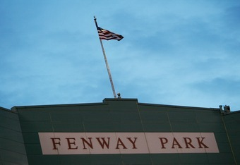 BOSTON - OCTOBER 14:  The American flag sways through the air above Fenway Park main entrance during Game five of the 2003 American League Championship Series between the Boston Red Sox and the New York Yankees at Fenway Park on October 14, 2003 in Boston