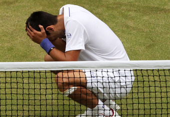 LONDON, ENGLAND - JULY 03:  Novak Djokovic of Serbia celebrates after winning his final round Gentlemen's match against Rafael Nadal of Spain on Day Thirteen of the Wimbledon Lawn Tennis Championships at the All England Lawn Tennis and Croquet Club on Jul