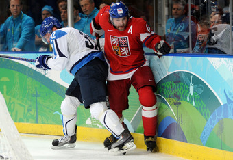 VANCOUVER, BC - FEBRUARY 24:  Jaromir Jagr #68 of Czech Republic fights for the puck against Toni Lydman #32 of Finland during the ice hockey men's quarter final game between Finland and the Czech Republic on day 13 of the Vancouver 2010 Winter Olympics a