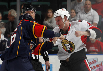 SUNRISE, FL - MARCH 31: Francis Lessard #49 of the Ottawa Senators and Darcy Hordichuk #16 of the Florida Panthers fight during the first period on March 31, 2011 at the BankAtlantic Center in Sunrise, Florida. (Photo by Joel Auerbach/Getty Images)