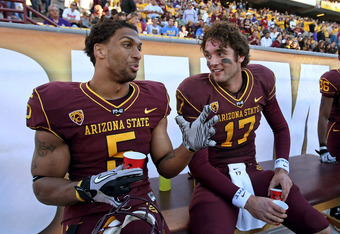 Taylor and Sun Devil QB Brock Osweiler sharing laughs during ASU's 55-34 win vs. UCLA