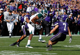 EVANSTON, IL - OCTOBER 23: Bennie Fowler #13 of the Michigan State Spartans catches a first down pass on a fake punt as Jordan Mabin #26 and Hunter Bates #7 of the Northwestern Wildcats close in for the tackle at Ryan Field on October 23, 2010 in Evanston