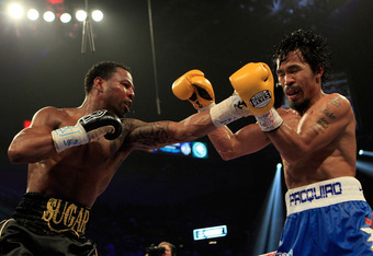 LAS VEGAS, NV - MAY 07:  (L-R) Shane Mosley connects with a left to the face of Manny Pacquiao of the Philippines in the WBO welterweight title fight at MGM Grand Garden Arena on May 7, 2011 in Las Vegas, Nevada.  (Photo by Chris Trotman/Getty Images)