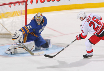 BUFFALO, NY - MARCH 15: Ryan Miller #30 of the Buffalo Sabres makes a save on a breakaway by Erik Cole #26 of the Carolina Hurricanes at HSBC Arena on March 15, 2011 in Buffalo, New York. Carolina won 1-0. (Photo by Rick Stewart/Getty Images)