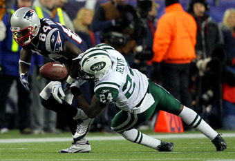 FOXBORO, MA - JANUARY 16:  Darrelle Revis #24 of the New York Jets breaks up a pass intended for Deion Branch #84 of the New England Patriots during their 2011 AFC divisional playoff game at Gillette Stadium on January 16, 2011 in Foxboro, Massachusetts.