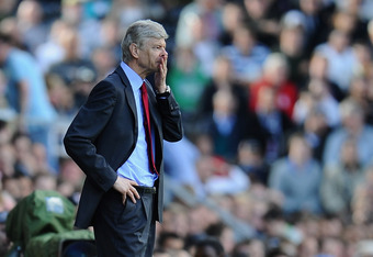 LONDON, ENGLAND - MAY 22:  Arsene Wenger of Arsenal shows his emotions during the Barclays Premier League match between Fulham and Arsenal at Craven Cottage on May 22, 2011 in London, England.  (Photo by Clive Mason/Getty Images)