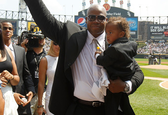 CHICAGO - AUGUST 29: Former player Frank Thomas of the Chicago White Sox walks off the field with his son Frank Thomas III after the White Sox retired his number 35 during a ceremony before a game against the New York Yankees at U.S. Cellular Field on Aug
