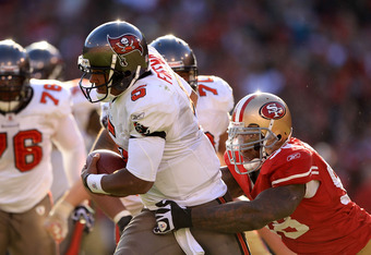 SAN FRANCISCO - NOVEMBER 21:  Josh Freeman #5 of the Tampa Bay Buccaneers is tackled by Parys Haralson #98 of the San Francisco 49ers at Candlestick Park on November 21, 2010 in San Francisco, California.  (Photo by Ezra Shaw/Getty Images)