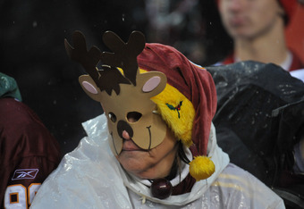 LANDOVER, MD - DECEMBER 12:  A fan of the Washington Redskins watches the game against the Tampa Bay Buccaneers  at FedExField on December 12, 2010 in Landover, Maryland. The Buccaneers defeated the Redskins 17-16. (Photo by Larry French/Getty Images)