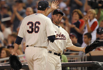 MINNEAPOLIS, MN - JULY 5: Michael Cuddyer #5 of the Minnesota Twins congratulates Joe Nathan #36 of the Minnesota Twins on the after the top half of the eighth inning against the Tampa Bay Rays on July 5, 2011 at Target Field in Minneapolis, Minnesota. Th