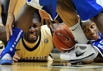 NASHVILLE, TN - FEBRUARY 12:  Festus Ezeli #3 of the Vanderbilt Commodores goes to the floor with Brandon Knight #12 of the Kentucky Wildcats as they battle for a loose ball at Memorial Gym on February 12, 2011 in Nashville, Tennessee. Vanderbilt won 81-7