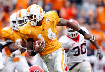 KNOXVILLE, TN - OCTOBER 10: Eric Berry #14 of the Tennessee Volunteers runs with the ball after intercepting a pass during the SEC game against the Georgia Bulldogs at Neyland Stadium on October 10, 2009 in Knoxville, Tennessee. (Photo by Andy Lyons/Getty