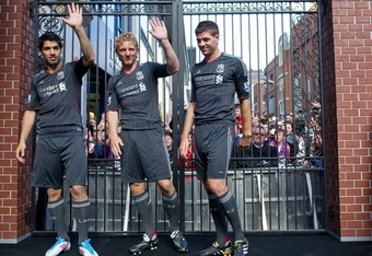 DUBLIN, IRELAND - MAY 12:  (L-R) Dirk Kuyt, Steven Gerrard and Luis Suarez of Liverpool FC launch the new Liverpool away kit in front of the Shankly Gates as adidas bring iconic pieces from Liverpool FC to the city on May 12, 2001 in Dublin, Ireland.  (Ph