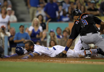 LOS ANGELES, CA - JULY 5:  Catcher Ronny Paulino #9 of the New York Mets tags out Matt Kemp #27 of the Los Angeles Dodgers at home plate in the fourth inning on July 5, 2011 at Dodger Stadium in Los Angeles, California.   (Photo by Stephen Dunn/Getty Imag