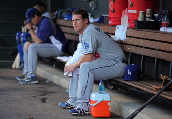 DENVER, CO - JUNE 10:  Starting pitcher Chad Billingsley #58 of the Los Angeles Dodgers looks on from the dugout prior to facing the Colorado Rockies at Coors Field on June 10, 2011 in Denver, Colorado. Billingsley collected the loss as the Rockies defeat