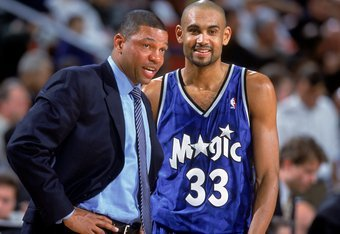 12 Dec 2000:  Grant Hill #33 of the Orlando Magic smiles and looks on with Head Coach ''Doc'' Rivers during the game against the Seattle SuperSonics at the Key Arena in Seattle, Washington.  The SuperSonics defeated the Magic 97-92.    NOTE TO USER: It is