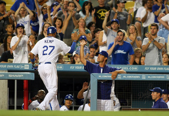 Dodgers skipper Don Mattingly salutes All-Star Matt Kemp after he scores in the sixth inning. Kemp's two-run double earlier in the inning was the key hit in a five-run inning for the Dodgers.