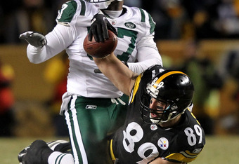 PITTSBURGH, PA - JANUARY 23:  Matt Spaeth #89 of the Pittsburgh Steelers holds up the ball after he made a reception against Bart Scott #57 of the New York Jets during the 2011 AFC Championship game at Heinz Field on January 23, 2011 in Pittsburgh, Pennsy