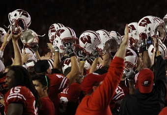 MADISON, WI - OCTOBER 16: Fans and players of the Wisconsin Badgers celebrate a win over the Ohio State Buckeyes at Camp Randall Stadium on October 16, 2010 in Madison, Wisconsin. Wisconsin defeated Ohio State 31-18. (Photo by Jonathan Daniel/Getty Images