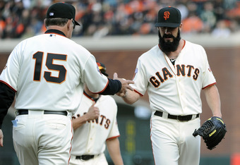 SAN FRANCISCO, CA - APRIL 8: Brian Wilson #38 of the San Francisco Giants is taken out of the game and hands the ball over to manager Bruce Bochy #15 after giving up the lead against the St. Louis Cardinals in the 9th inning during a MLB baseball game at