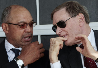 MOBILE, AL - APRIL 14:  Baseball Hall of Famer Reggie Jackson (L) talks with MLB Commissioner Bud Selig during ceremonies opening the Hank Aaron Museum at the Hank Aaron Stadium on April 14, 2010 in Mobile, Alabama. (Photo by Dave Martin/Getty Images)