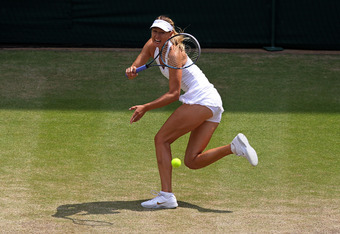 LONDON, ENGLAND - JULY 02:  Maria Sharapova of Russia returns a shot during her Ladies' final round match against Petra Kvitova of the Czech Republic on Day Twelve of the Wimbledon Lawn Tennis Championships at the All England Lawn Tennis and Croquet Club