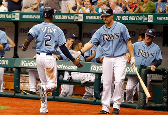 ST. PETERSBURG, FL - MAY 01:  Outfielder B.J. Upton #2 of the Tampa Bay Rays is congratulated by Casey Kotchman #11 after scoring a run against the Los Angeles Angels of Anaheim during the game at Tropicana Field on May 1, 2011 in St. Petersburg, Florida.
