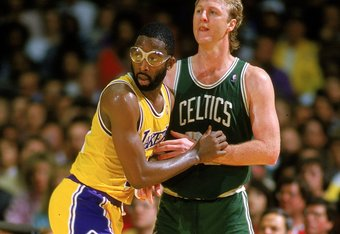 Undated: James Worthy of the Los Angeles Lakers blocks Larry Bird of the Boston Celtics.  Mandatory Credit: Rick Stewart  /Allsport