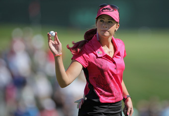 COLORADO SPRINGS, CO - JULY 08:  Paula Creamer reacts to the gallery after putting for par on the fourth hole during the continuation of the first round of the U.S. Women's Open at The Broadmoor on July 8, 2011 in Colorado Springs, Colorado.  (Photo by Do
