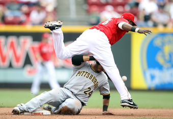 CINCINNATI, OH - MAY 19:  Pedro Alvarez #24 of the Pittsburgh Pirates breaks up a force out at second base as Edgar Renteria #16 of the Cincinnati Reds drops the ball during the game at Great American Ball Park on May 19, 2011 in Cincinnati, Ohio.  The Pi