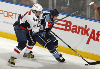 Mike Weaver holds off Alex Ovechkin