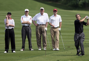 BIRMINGHAM, AL - MAY 14: (L-R) Tom Kite, Steve Hudson, Univ. of Alabama Athletic Director Mal Moore and former Univ. of Alabama golfer Gator Todd watch as Nick Saban hits his approach shot to the 4th hole during the Regions Charity Classic at the Robert T
