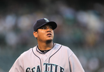 OAKLAND, CA - JULY 05:  Felix Hernandez #34 of the Seattle Mariners walks back to the dugout in between innings against the Oakland Athletics at Oakland-Alameda County Coliseum on July 5, 2011 in Oakland, California.  (Photo by Ezra Shaw/Getty Images)