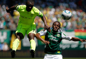 PORTLAND, OR - JULY 10: Jhon Kennedy Hurtado #34 of the Seattle Sounders battles Jorge Perlaza #15 of the Portland Timbers on July 10, 2011 at Jeld-Wen Field in Portland, Oregon. (Photo by Jonathan Ferrey/Getty Images)