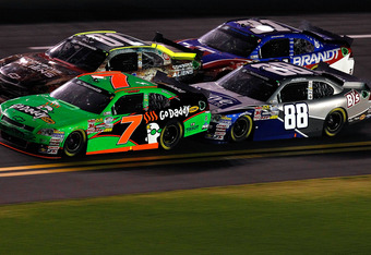 DAYTONA BEACH, FL - JULY 01:  Danica Patrick, driver of the #7 GoDaddy.com Chevrolet, and Aric Almirola, driver of the #88 Suave Men Chevrolet, race during the NASCAR Nationwide Series Subway Jalapeno 250 Powered by Coca-Cola at Daytona International Spee