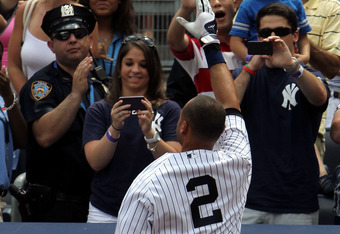 The Captain gives a curtain call to the sellout crowd at Yankee Stadium following his 3,000th hit.