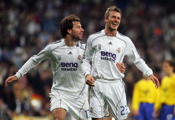MADRID, SPAIN - NOVEMBER 09:  David Beckham (R) of Real Madrid celebrates with Ruud van Nistelrooy after scoring a goal against Ecija during the Kings Cup fourth round second leg match between Real Madrid and Ecija at the Santiago Bernabeu stadium on Nove