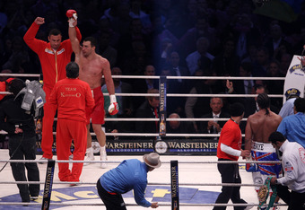 HAMBURG, GERMANY - JULY 02:  Wladimir Klitschko celebrates with his brother Vitali Klitschko on the final bell after his heavey weight title fight with David Haye at the Imtech Arena on July 2, 2011 in Hamburg, Germany.  (Photo by Scott Heavey/Getty Image
