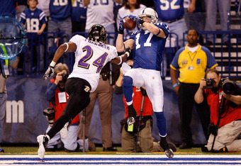 INDIANAPOLIS - JANUARY 16:  Austin Collie #17 of the Indianapolis Colts catches a 10-yard touchdown pass in the second quarter over Domonique Foxworth #24 of the Baltimore Ravens in the AFC Divisional Playoff Game at Lucas Oli Stadium on January 16, 2010