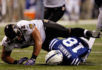 INDIANAPOLIS - JANUARY 16:  Peyton Manning #18 of the Indianapolis Colts is sacked by Haloti Ngata #92 of the Baltimore Ravens in the third quarter of the AFC Divisional Playoff Game at Lucas Oli Stadium on January 16, 2010 in Indianapolis, Indiana.  (Pho