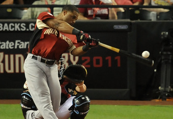 PHOENIX, AZ - JULY 11:  American League All-Star Robinson Cano #24 of the New York Yankees hits during the final round of the 2011 State Farm Home Run Derby at Chase Field on July 11, 2011 in Phoenix, Arizona. Cano won the 2011 State Farm Home Run Derby w