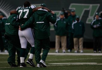 EAST RUTHERFORD, NJ - OCTOBER 18: Kris Jenkins #77 of the New York Jets walks off the field with an injury with help from the medical staff against the Buffalo Bills during the game on October 18, 2009 at Giants Stadium in East Rutherford, New Jersey. The