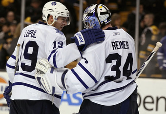 BOSTON, MA - MARCH 31:  James Reimer #34 of the Toronto Maple Leafs is congratulated by teammate Joffrey Lupul #19 after the game against the Boston Bruins on March 31, 2011 at the TD Garden in Boston, Massachusetts. The Toronto Maple Leafs defeated the B