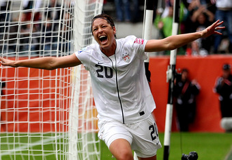 MOENCHENGLADBACH, GERMANY - JULY 13:  Abby Wambach of the USA celebrates as her side takes a 1-0 lead during the FIFA Women's World Cup 2011 Semi Final match between France and USA at Borussia Park on July 13, 2011 in Moenchengladbach, Germany.  (Photo by