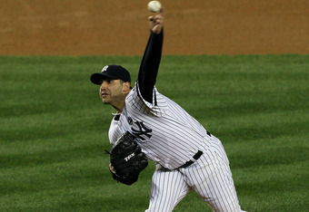 NEW YORK - OCTOBER 18:  Starting pitcher Andy Pettitte #46 of the New York Yankees pitches against the Texas Rangers in Game Three of the ALCS during the 2010 MLB Playoffs at Yankee Stadium on October 18, 2010 in New York, New York. The Raners won 8-0.  (
