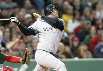 BOSTON - APRIL 20: Jason Giambi #25 of the New York Yankees swings at the pitch against the Boston Red Sox on April 20, 2007 at Fenway Park in Boston, Massachusetts. (Photo by Elsa/Getty Images)